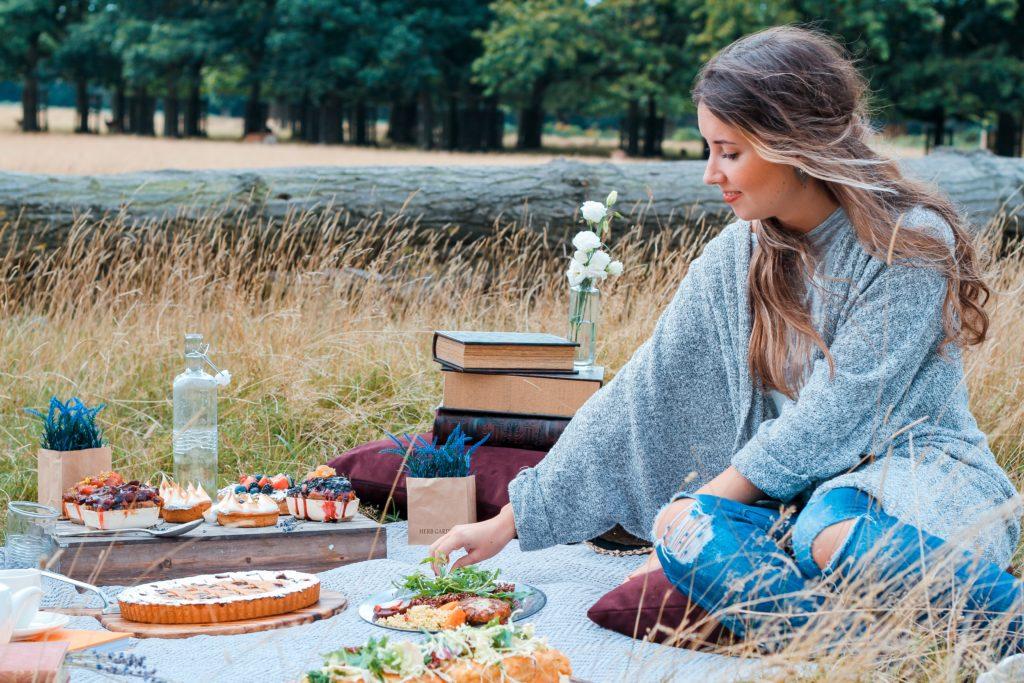 woman sitting on picnic mat