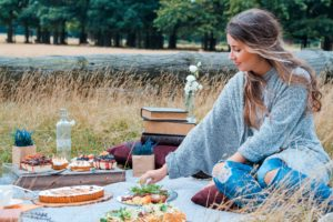 woman sitting on picnic mat